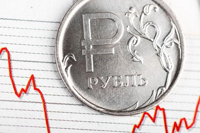 С чем связана девальвация рубля